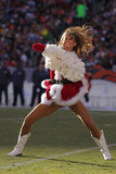 A member of the Denver Broncos cheerleaders really gets into her dance moves.
