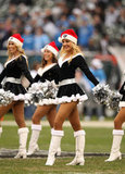 "The Raiderettes cheerleaders perform to the song ""Jingle Bells."""