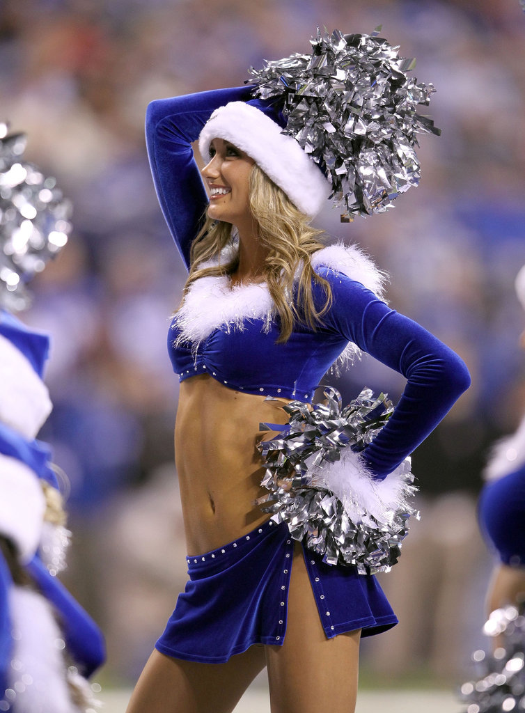 A Indianapolis Colts cheerleader performs in her blue and white outfit.