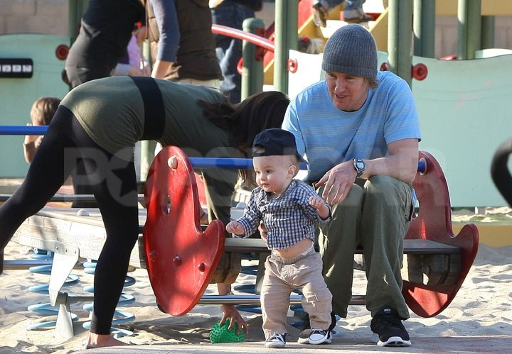 Owen Wilson pulled down baby Robert's shirt.