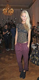 Poppy Delevigne counters a sexy, lace top with a pair of athletic-inspired bottoms.