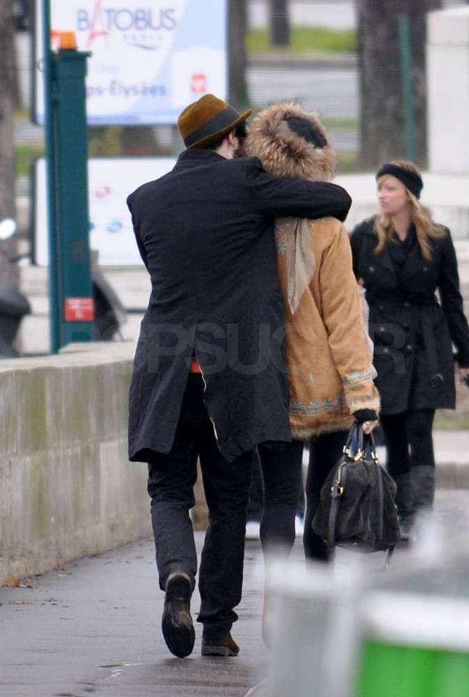 Tom Sturridge wrapped his arms around Sienna Miller.
