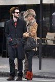 Sienna Miller hung onto Tom Sturridge.