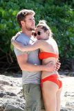 Miley Cyrus and Liam Hemsworth got cozy at the beach.