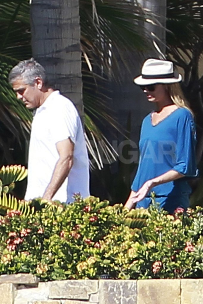 Stacy Keibler and George Clooney had a day in the sun together.