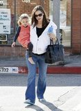 A pregnant Jennifer Garner toted her daughter, Seraphina Affleck, and a purse.