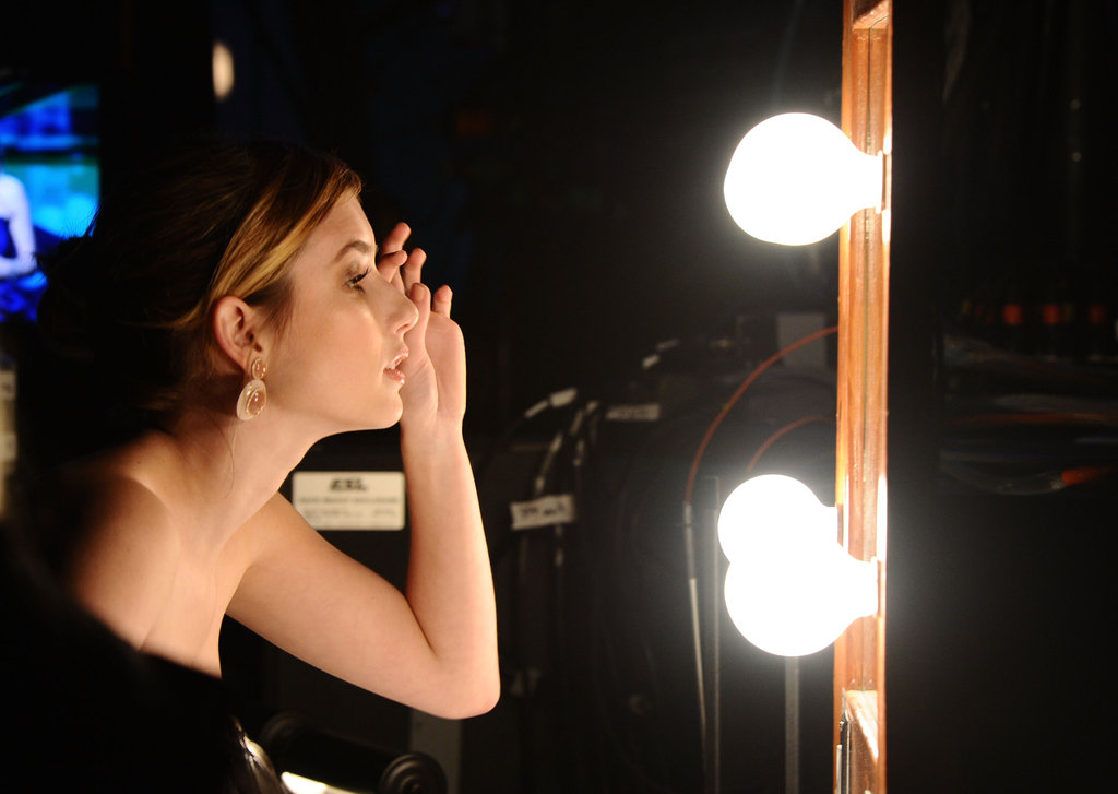 Emma Roberts was snapped primping backstage in 2011.