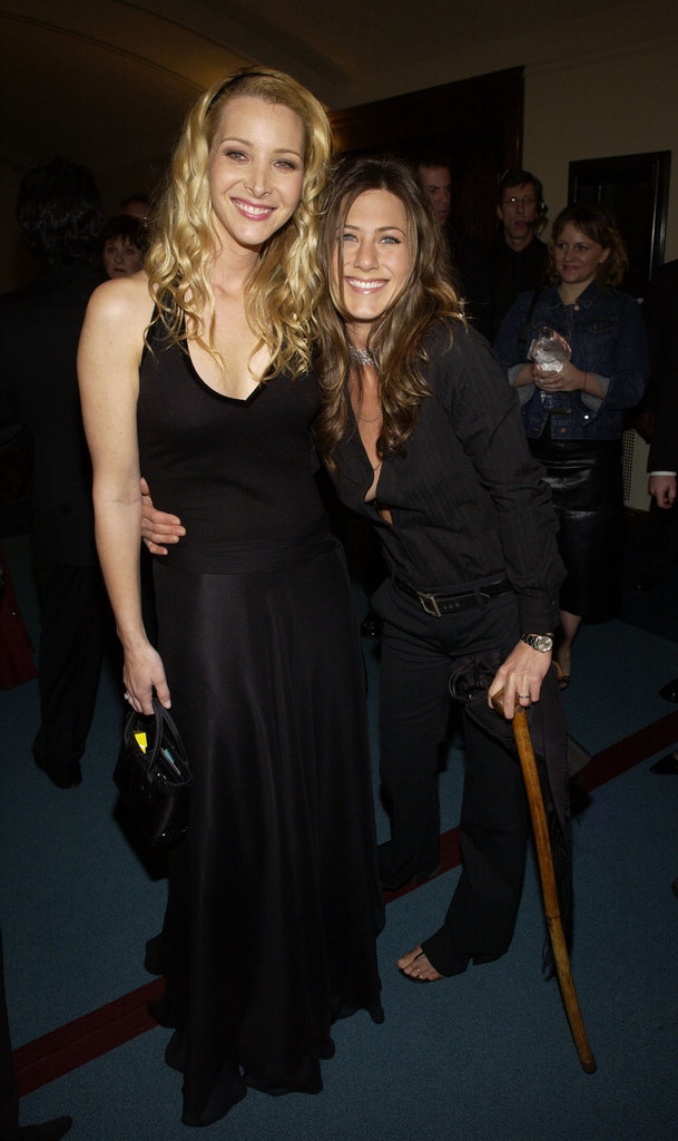 Jennifer Aniston leaned on a cane while posing backstage with Friends costar Lisa Kudrow in 2003.