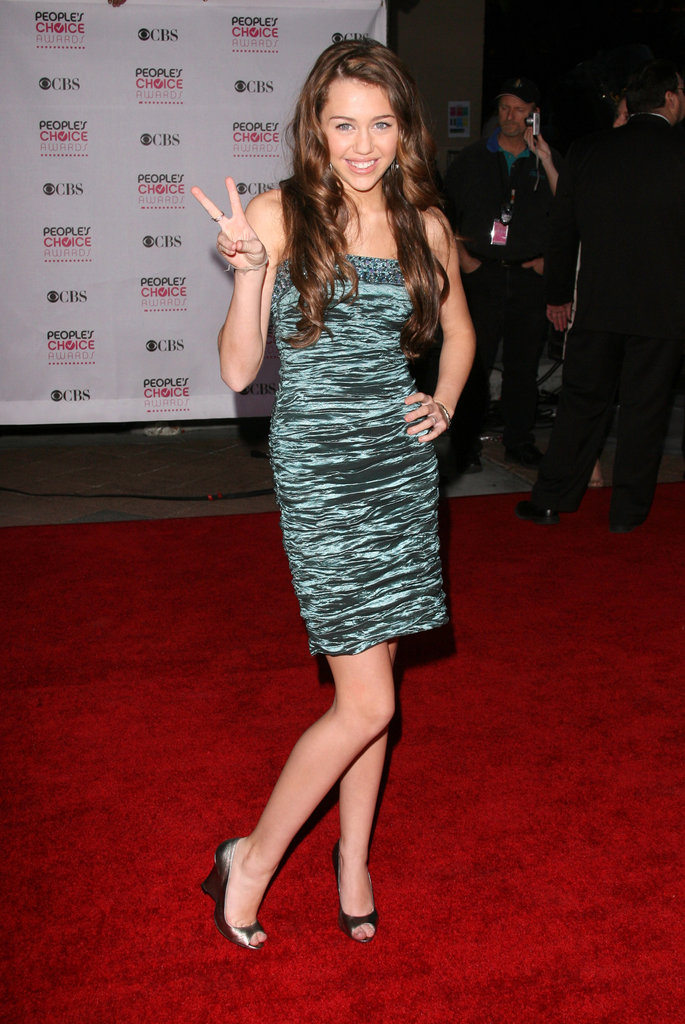 Miley Cyrus flashed a peace sign on the red carpet in 2007.