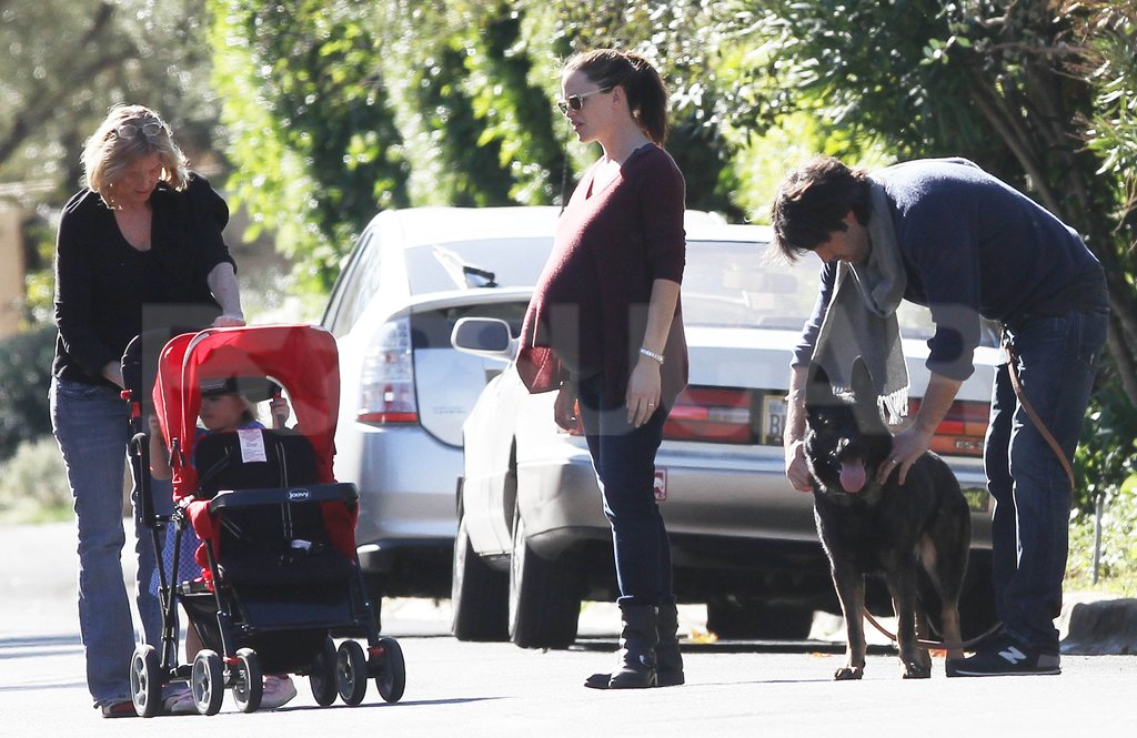 Ben Affleck pet his dog while pregnant Jennifer Garner talked to her mom, Pat.