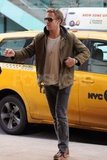 Ryan Gosling walked to a movie in NYC.
