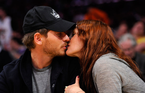 Drew Barrymore and Will Kopelman shared a sweet kiss during a break from game play during an April 2011 LA Lakers game.