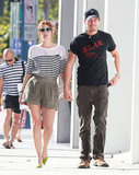 Drew Barrymore and Will Kopelman walked in step leaving Chanel in Beverly Hills during a July 2011 shopping trip.