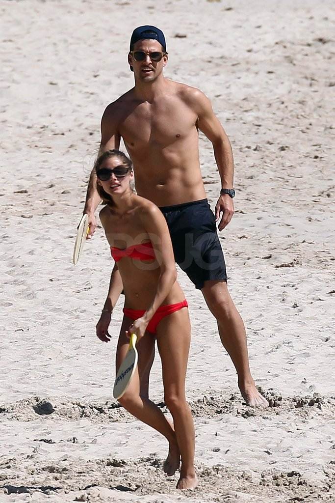 Olivia Palermo playing paddleball with shirtless boyfriend Johannes Huebl.