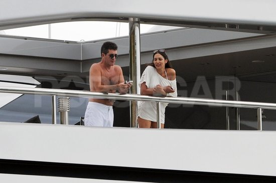 Simon Cowell chatted with a friend on his yacht in the morning.