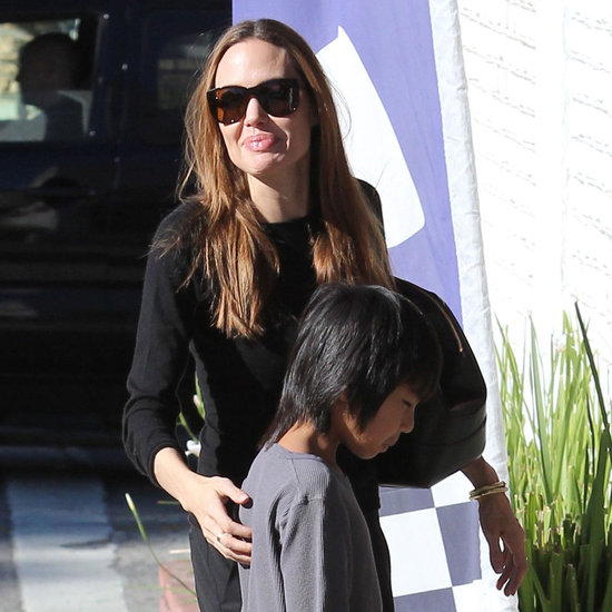 Angelina Jolie smiled on a day out with her boys.