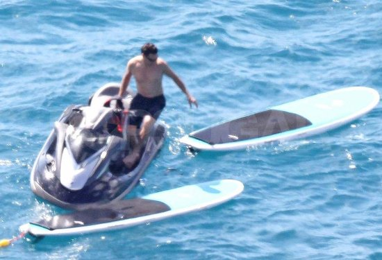 Ryan Seacrest shirtless on a jet ski.