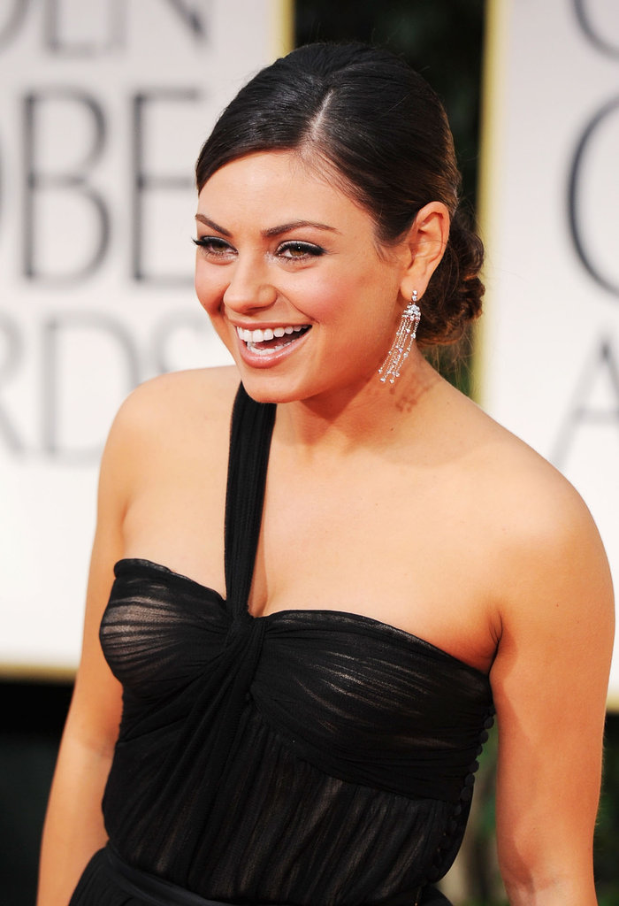 Mila Kunis smiled in her Dior dress.