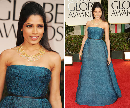Freida Pinto's Golden Globes look was as elegant as you'd expect. The natural beauty wore a blue Prada gown, cinched in at the waist with a diminutive black ribbon belt. Gold additions, via a stunning gold Chopard necklace and box clutch, were her accessories of choice.