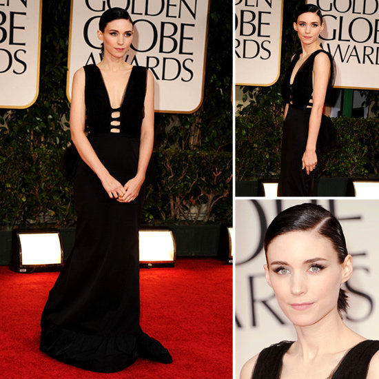 Rooney Mara, the star of The Girl With the Dragon Tattoo looks sleek and romantic in a black cutout gown from Nina Ricci's Pre-Fall 2012 collection, which she paired with a sleek ponytail and thick black eyeliner.