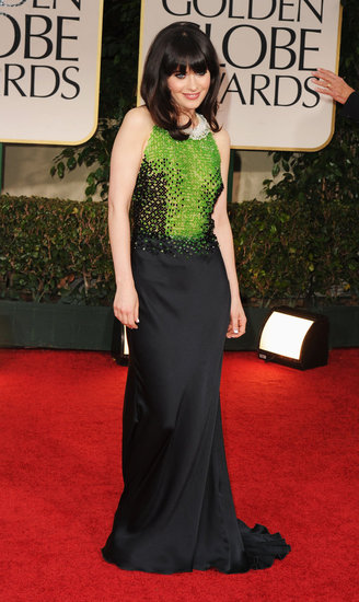 The New Girl actress Zooey Deschanel donned a sequined black and green Prada number that epitomized a retro glam feel. She paired a bright green clutch and quirky white choker to keep the bold sparkle theme going.