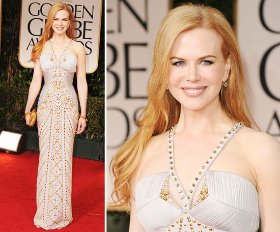 Nicole Kidman's floor-length, halter-style, gold and cream Versace number fit like a glove — and to keep the look bright and bold, she added matching gold cuff bangles and a gold clutch.