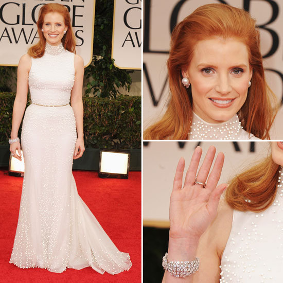 Jessica Chastain is the picture of modern femininity in a white, pearl-embellished Givenchy gown. The Help beauty — one of the stars to watch in 2012 — furthered the pretty vibe with a pair of jeweled pearl studs and a diamond bracelet.