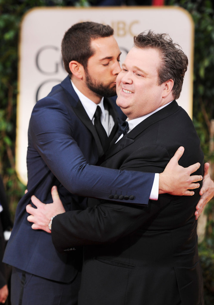 Chuck's Zachary Levi kisses Modern Family's Eric Stonestreet at the show.