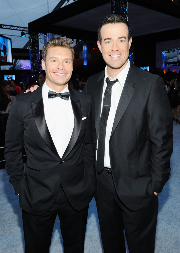 Red-carpet hosts Ryan Seacrest and Carson Daly hang out after the Golden Globes.