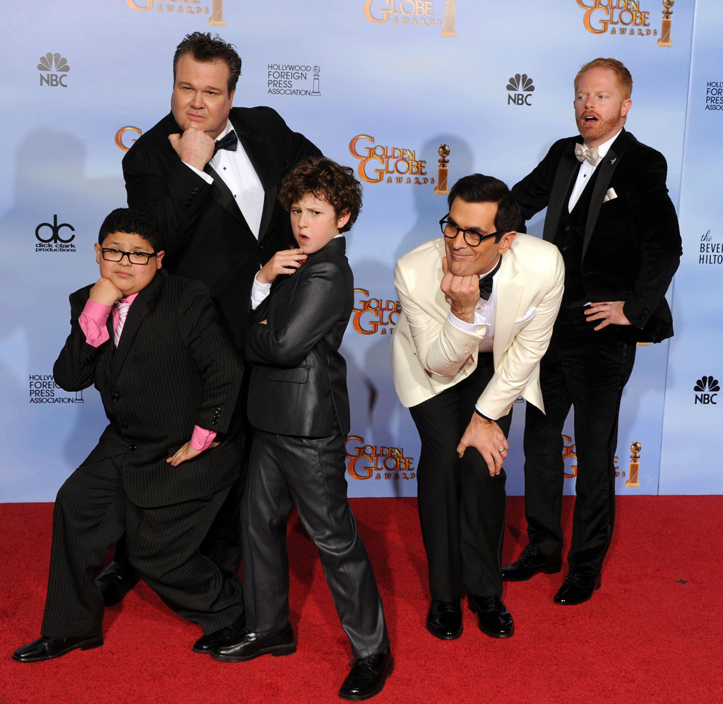 The men of Modern Family goof around.