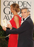 Stacy Keibler and George Clooney make their entrance.