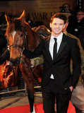 Actor Jeremy Irvine stands close to his costar.