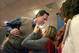 Rick Santorum leans in to kiss his wife during a campaign rally in Iowa.