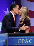 Mitt Romney kisses his wife before addressing the CPAC in Washington DC.
