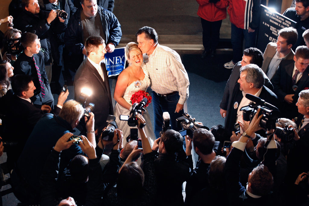 Mitt Romney kisses a newlywed during a campaign event in Iowa.