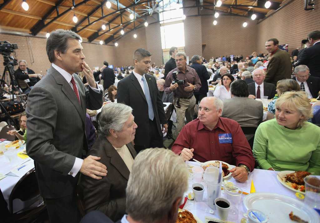 Rick Perry blows a kiss to guests at the Iowa Faith & Freedon Coalition Presidential Forum.