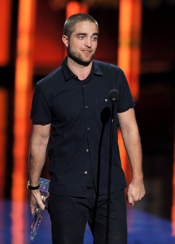 Robert Pattinson kept it casual in a button-up t-shirt.