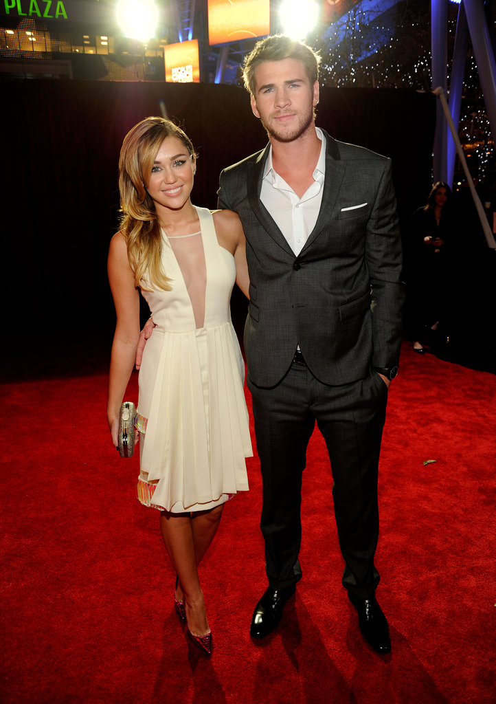 Miley Cyrus and Liam Hemsworth were affectionate on the red carpet.