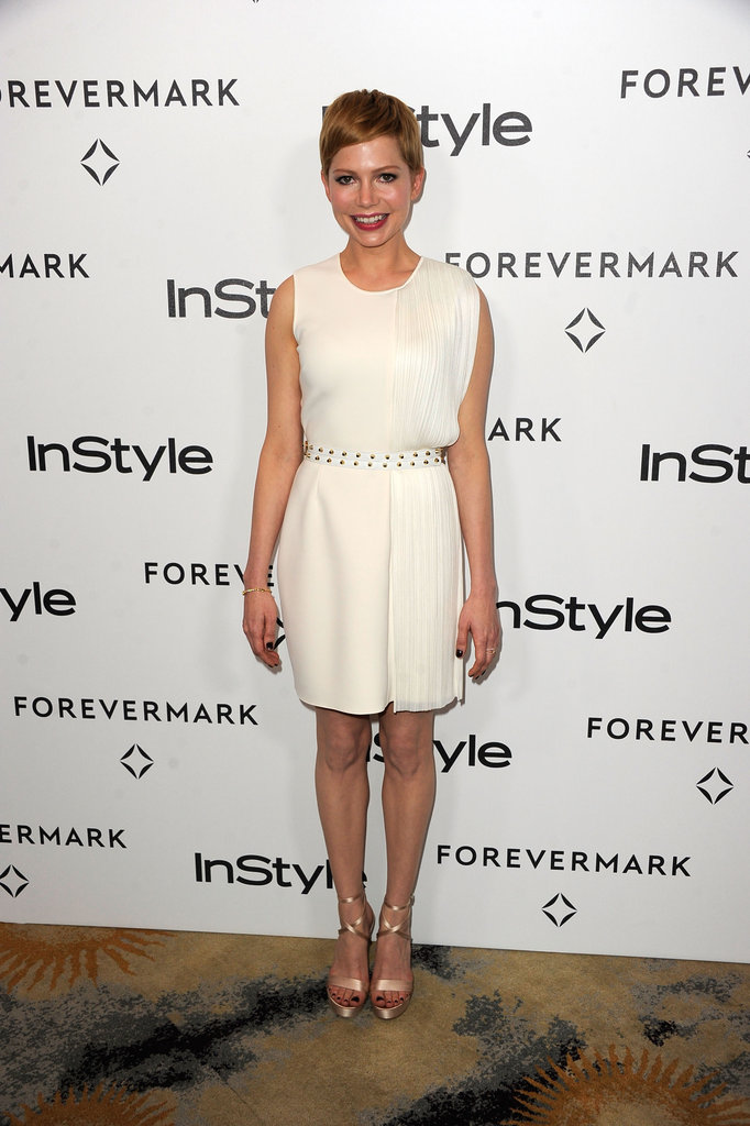 Michelle Williams played to her sweet signature style in a pretty LWD by Versace.