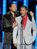 Terrence Howard hugs Cuba Gooding Jr. onstage.