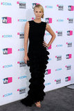 Charlize Theron posed in a layered black dress at the 2012 Critics' Choice Movie Awards.