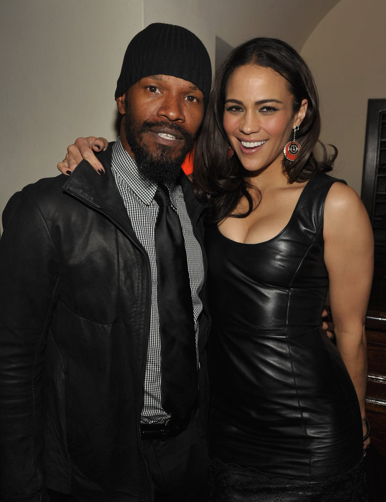 Jamie Foxx and Paula Patton shared a laugh at an award show party in LA.