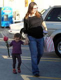 Seraphina Affleck carried a bouquet of flowers on a day out with mom Jennifer Garner.