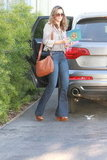 Jessica Alba made a styled run in flares and wedges.