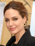 Angelina Jolie Suits Up and Smiles Big at a Pre-Golden Globes Event