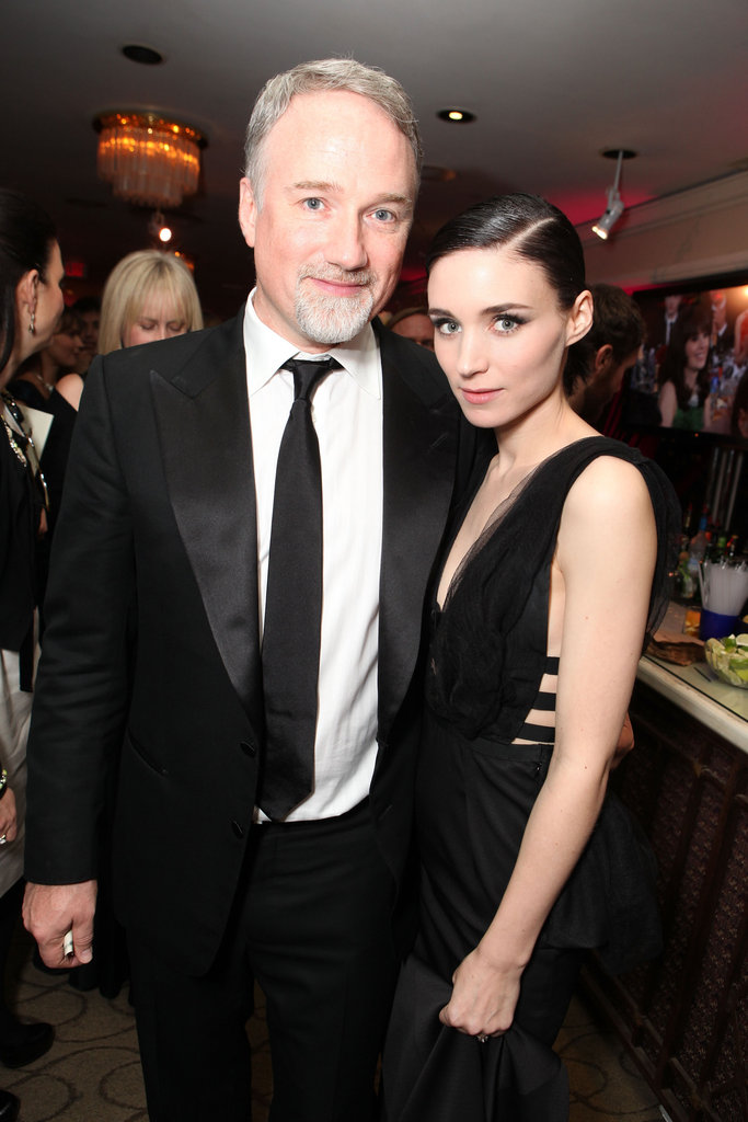 Director David Fincher and Rooney Mara posed for photos at the Sony Pictures Golden Globes party.