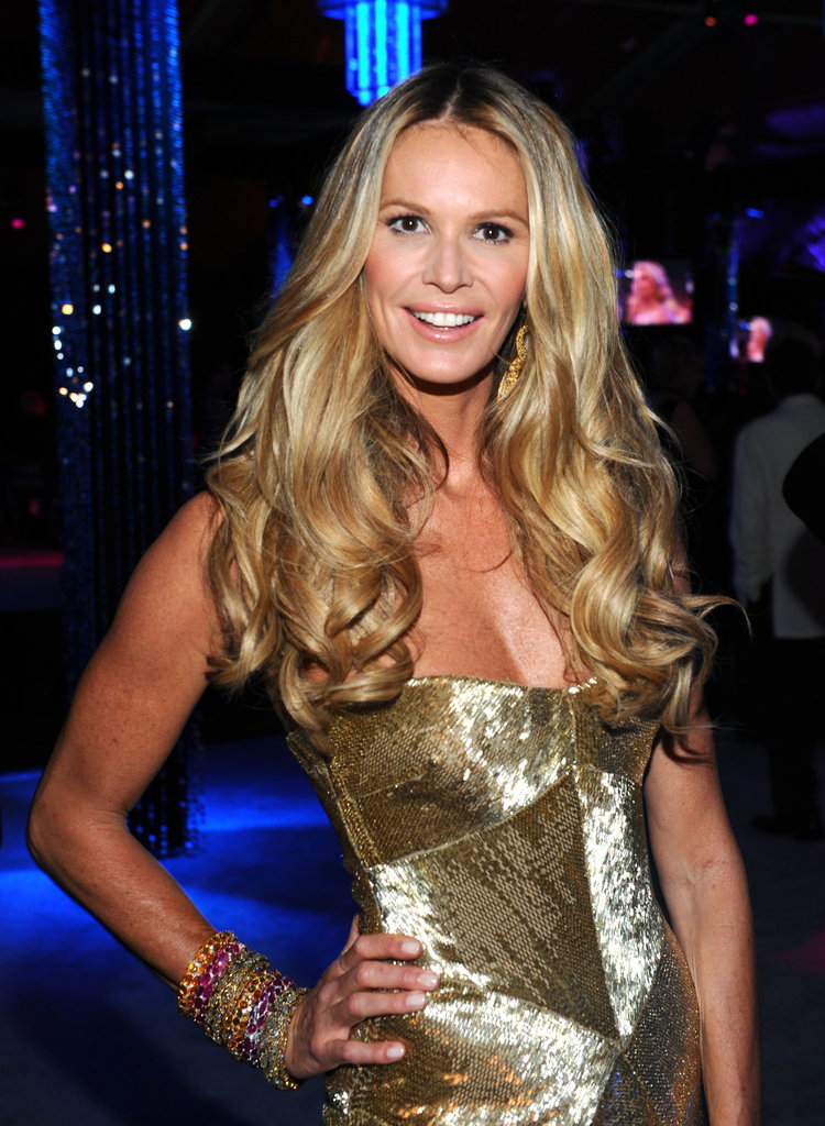 Elle Macpherson was radiant in gold.