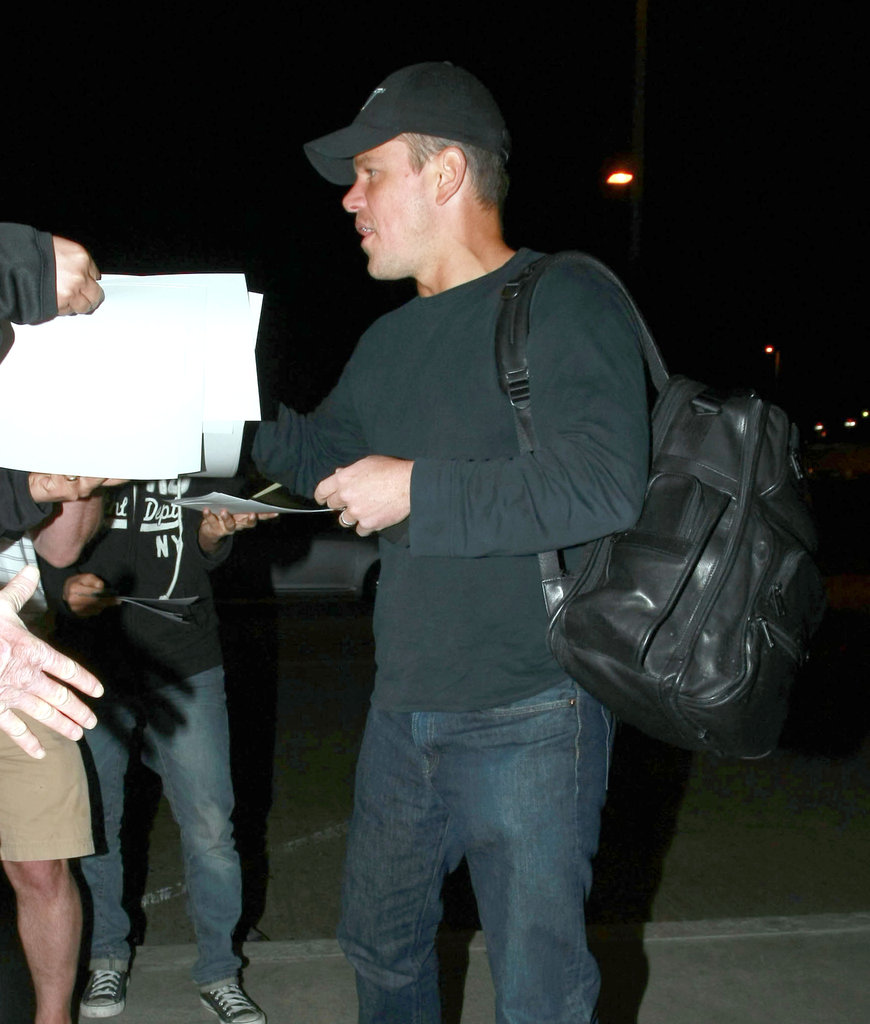 Matt Damon signing autographs for fans.