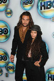 Game of Thrones' Jason Momoa and Lisa Bonet lock together on their way into the HBO party.