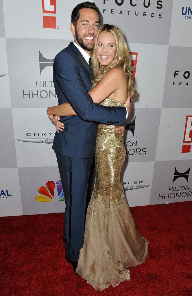 Actor Zachary Levi and Elle Macpherson share a friendly hug.